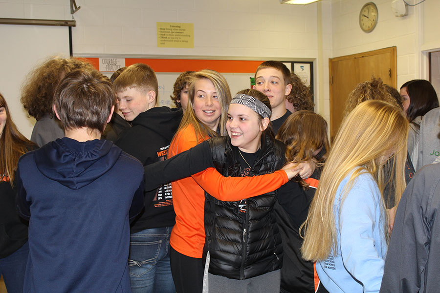Payton Lewin, Carlee Smith, Jenna Philipp, Jadyn Peyton and other students get tangled in a human knot after taking the reading ISASP test.