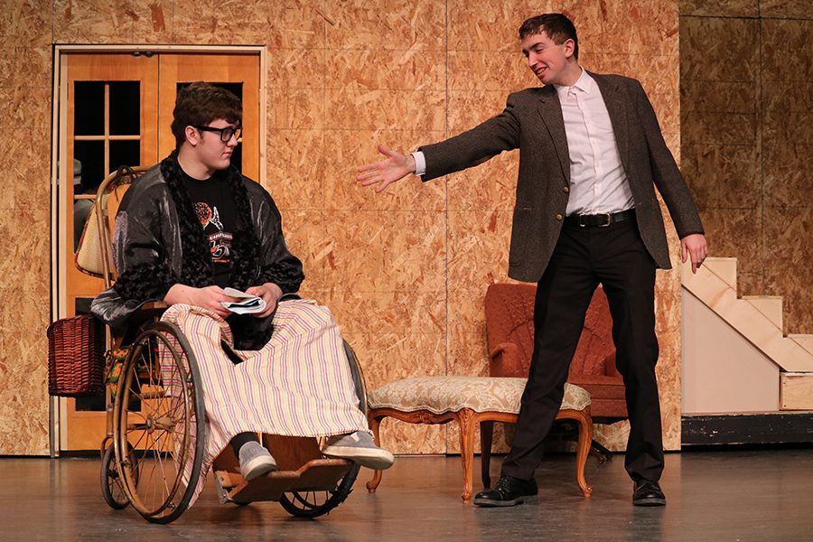 """Acting as Burt Jefferson, senior Ethan Opitz asks to shake senior Parker Ostrander's hand. Ostrander plays radio host Sheridan Whiteside, one of the lead roles in """"The Man Who Came To Dinner."""""""