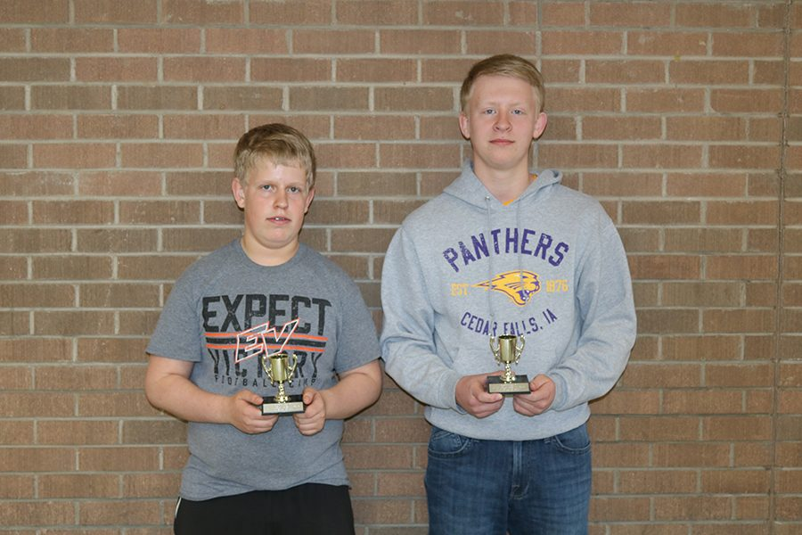 Euchre tournament winners,  freshmen Trevor Soppe and Phillip Ries show off their trophies.