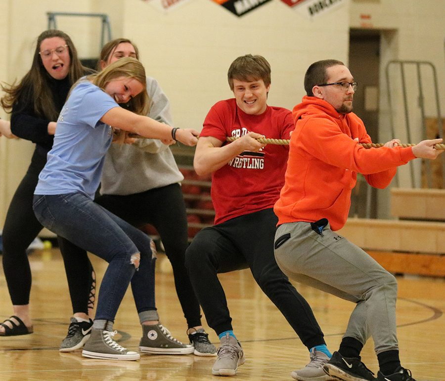 During the tug of war, seniors Olivia Neuzil, Emily Klostermann, Claire Demmer, Mitchel Mangold, and Ryan Phillips fight to beat the juniors. The seniors won the tug of war and were the overall ag olympic winners.