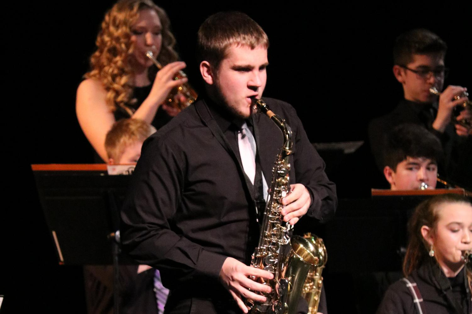 At Swing into Spring, junior Jacob Vaske plays the saxophone.