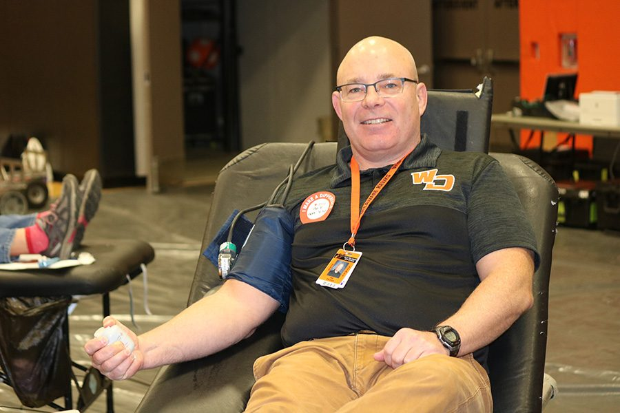 Teacher Pat Phillips donates blood during the previous blood drive in November 2018.