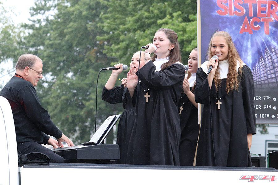 Teacher Duane Philgreen accompanies Kaylee Osterhaus (11), Denise Cherry (12), Anna Werner (11) and Lainey Robinson (10) as they sing a song from