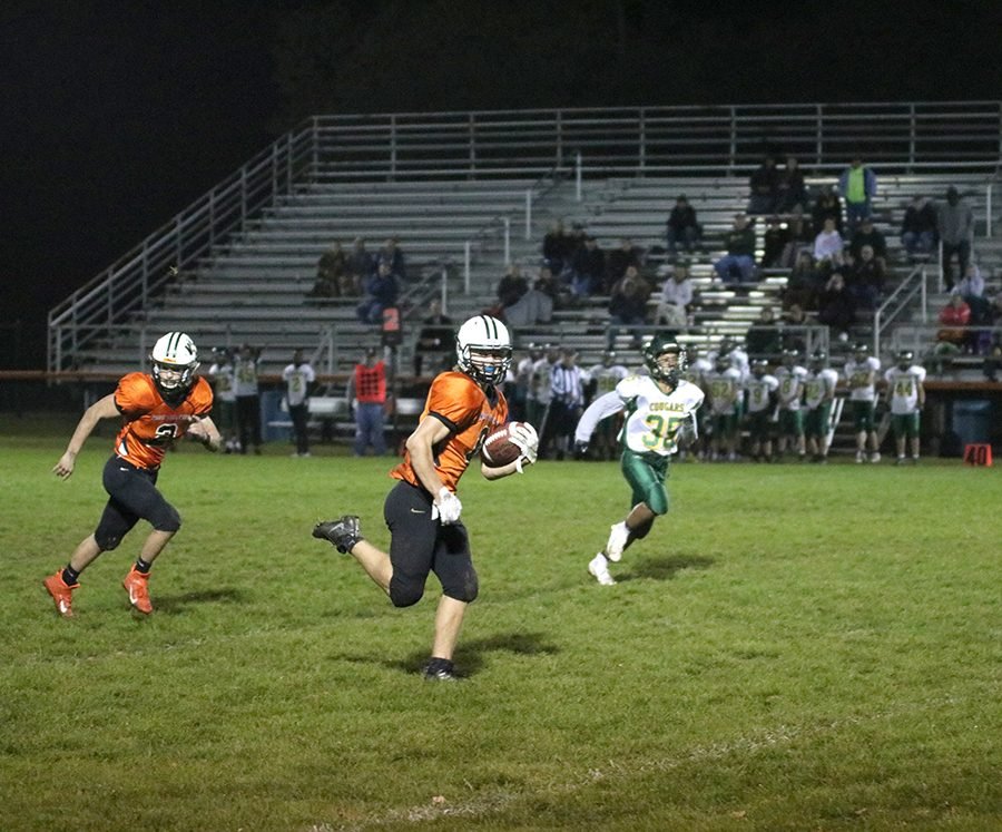 Closing in on the end zone, Will Ward (9) races for a Hawk touchdown.