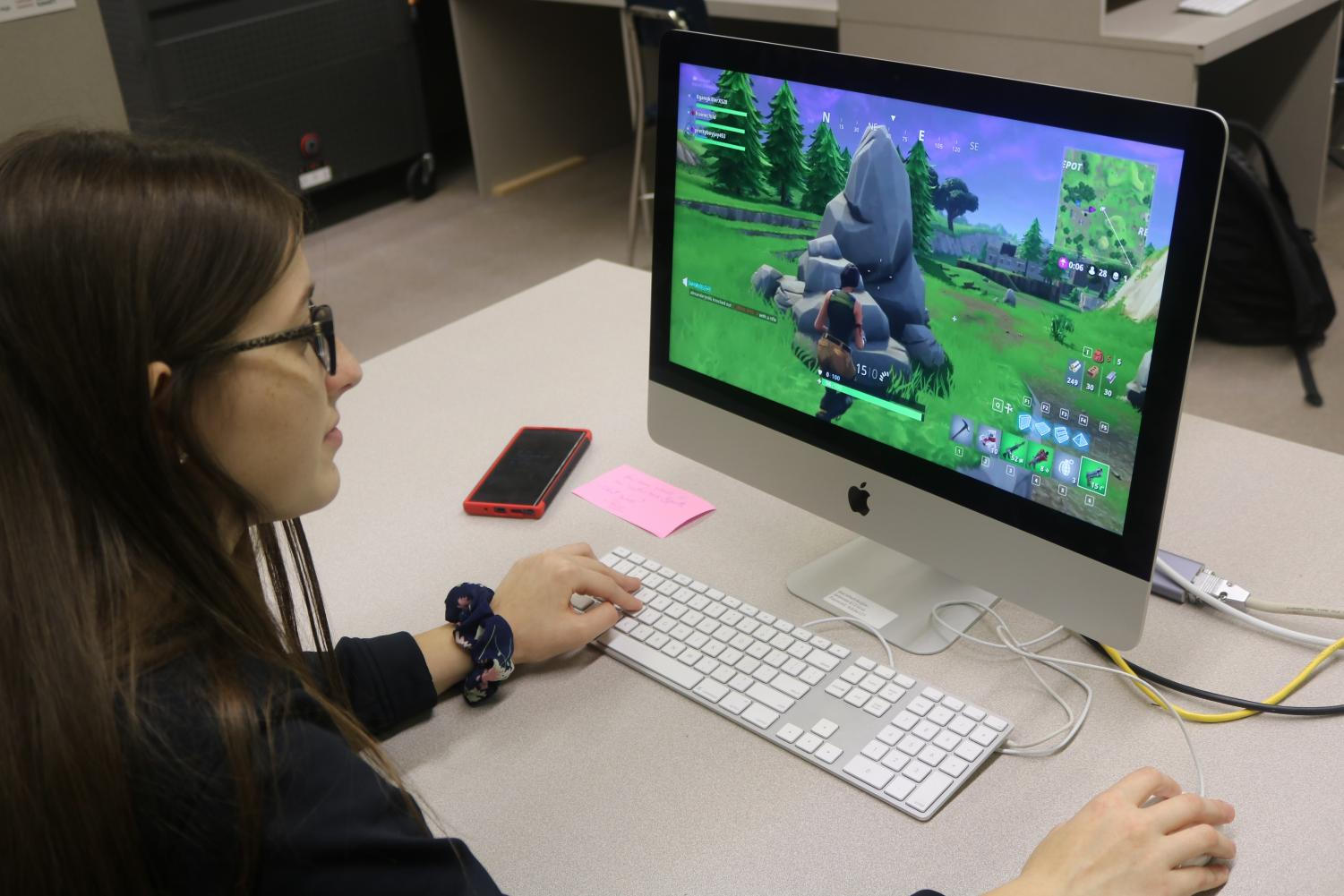 Emma Merkes (11) is engaged in playing a game of Fortnite.