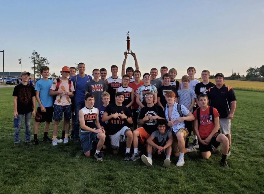 The boys cross country team celebrates their first place win at the Vinton-Shellsburg Invitational.