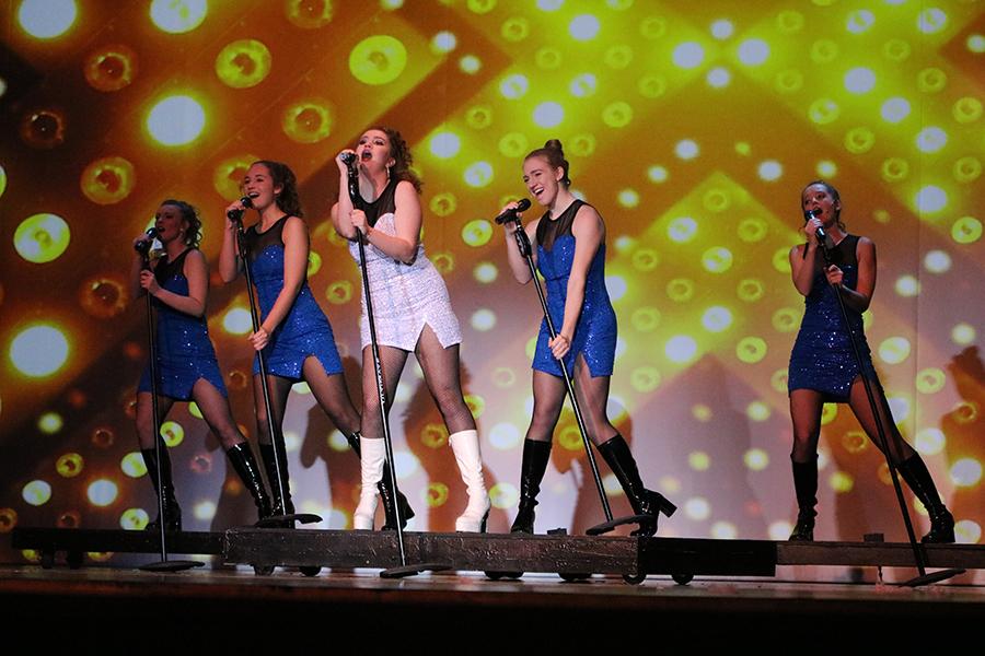 During a dress rehearsal on Nov. 6, Karsyn Welcher (11), Laney Robinson (10), Sheeley McMahon (11), Addison Reetz (11) and Rebecca Farmer (11) sing together.