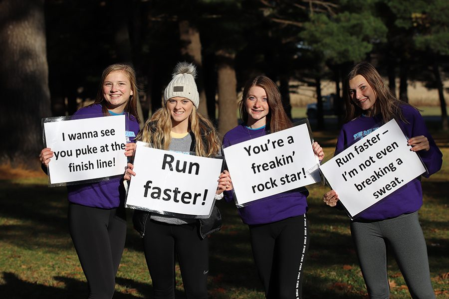 """At the districts cross country meet in Independence, Makayla Gasper (10), Karsyn Welcher (11), Kaleah Carter (12), and Keara Emerson (9) support West Delaware runners. """"The atmosphere was pretty intense, [and] everybody wanted to do good,"""" Welcher said."""