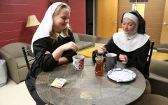 Before dress rehearsal, Kaylee Osterhaus (11) and Kaleah Carter (12) enjoy their tea.