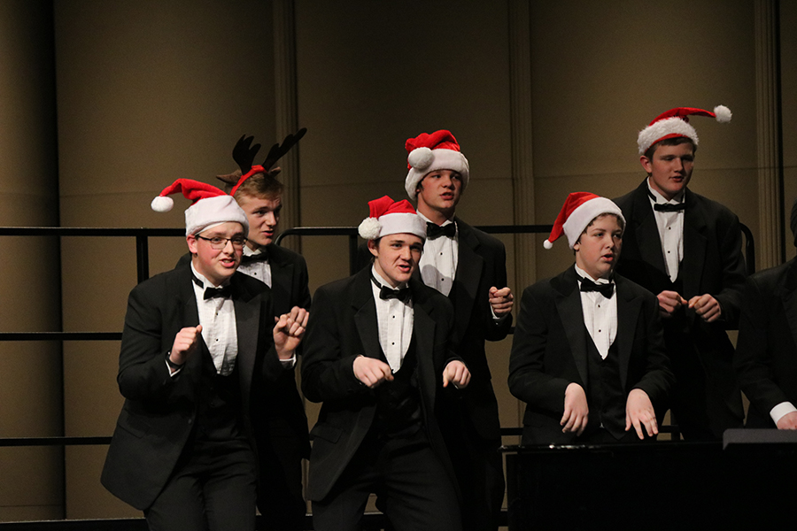 Kalen Recker (11), Alias Underwood (11), Joshua Seeley (11), Myles Ponsar (10), Trey Boczkowski (9) and Elijah Heims (12) act out choreography with the rest of the Bass Clef Chorus. The choir members whipped out various pieces of Christmas clothing (including hats) for the last song,