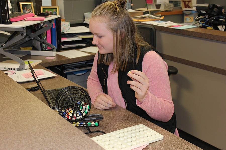 Lydia Heims (9) announces numbers for Turkey Bingo. As a whole, students received around 70 candy snacks and 25 T-shirts.