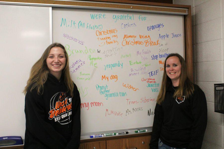Teachers Jennie Voss and Melissa Hauschild show off Voss' grateful board.