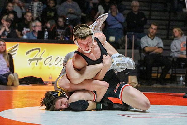 Freshman Logan Peyton works to gain an escape against the Go-Hawks 138-pounder. Peyton won his match by technical fall, 20-6.