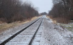 A slight layer of fresh snow rests on a railroad. While Manchester is located far from the North Pole, Christmas cheer is still found at West Delaware.