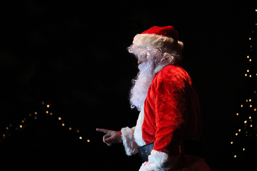 Ian Rodgers (11) as Santa sings a song in the auditorium.