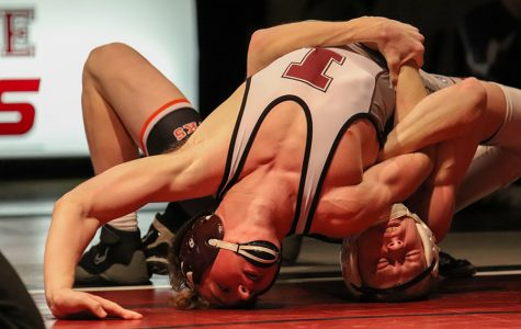 Logan Peyton attempts to pin Independence wrestler, 138-pounder Tyler Trumblee. Peyton pinned Trumblee in 2:32.