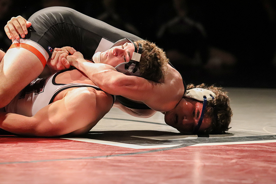 Jack Neuhaus (12) captures 182-pounder Marcus Beatty in a headlock and tries to ease his shoulders down to the mat for a pin. Neuhaus is ranked second in Class 2A.