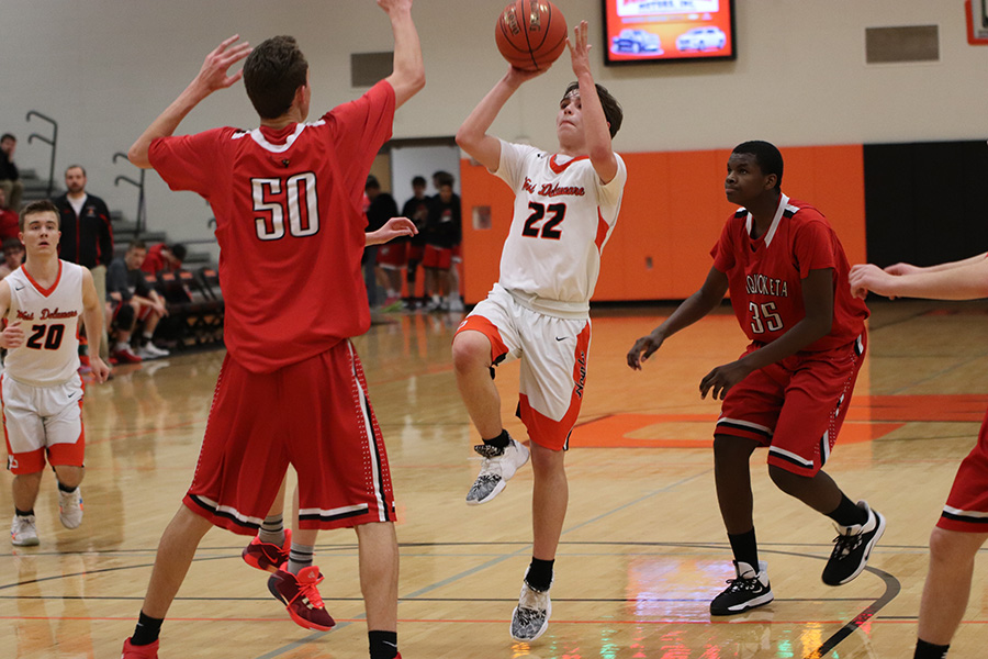 With the clock counting down, Maddux Lott (9) shoots for the hoop.