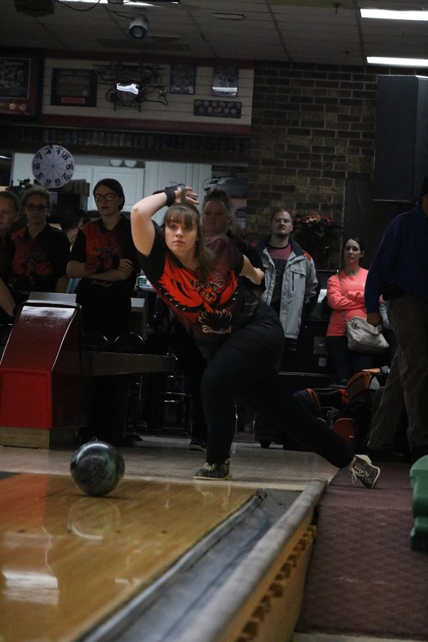 Looking to score more team points, Regan Recker (11) rolls the bowling ball down the lane.
