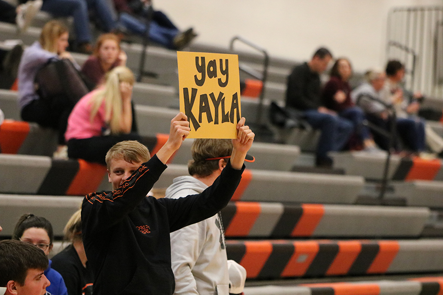 Senior Parker Kluesner proudly supports sophomore Kayla Felton along with the rest of the team. Kluesner is an avid student section member.