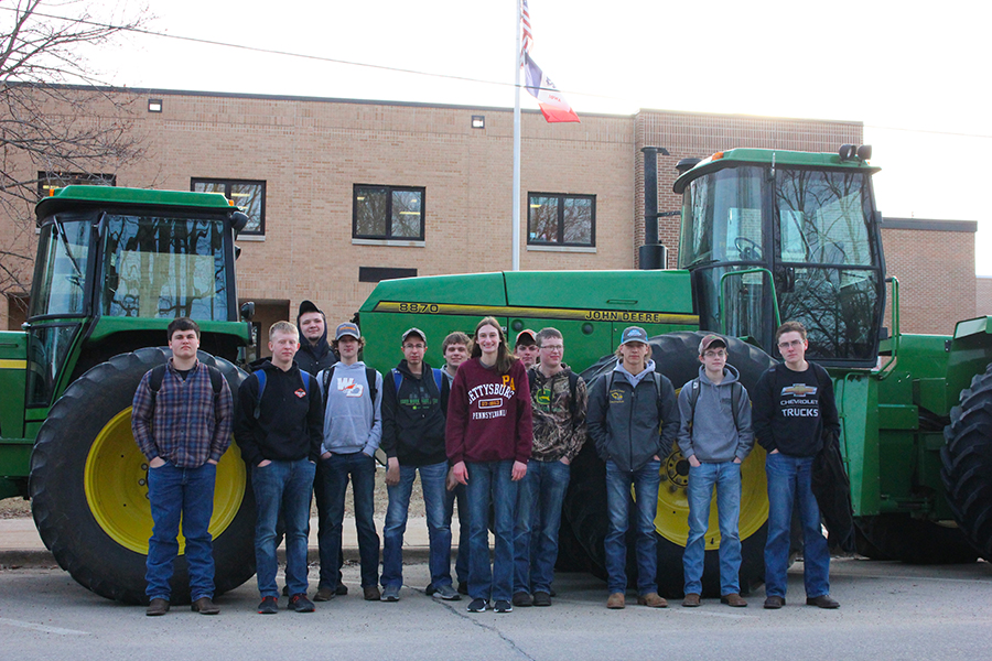 During FFA week, Mitchell McDonald (10), Phillip Ries (10), Mitchell Krogmann (11), Noah Jackson (10), Kyle Deutmeyer (11), Cody Monaghan (10), Lori Hilby (10), Blake Deutmeyer (10), Andrew Ries (10), Thomas Crane (10), Trent Deutmeyer (10) and Levi Mullis (12) pose in front of their tractors on Tractor Day.