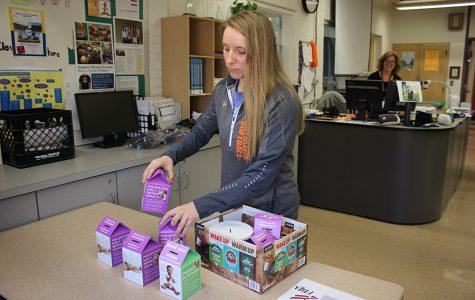 FBLA member Lexi Hartman (11) sorts through coin boxes.