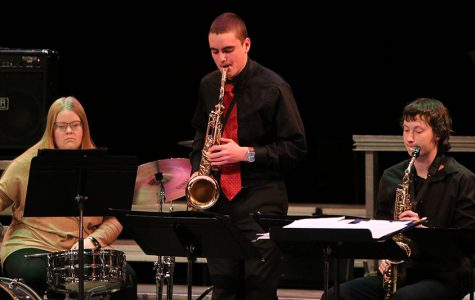 Natalie Kehrli, Jacob Wenger, and Tanner Kelchen play in Jazz Band I at Swing into Spring.