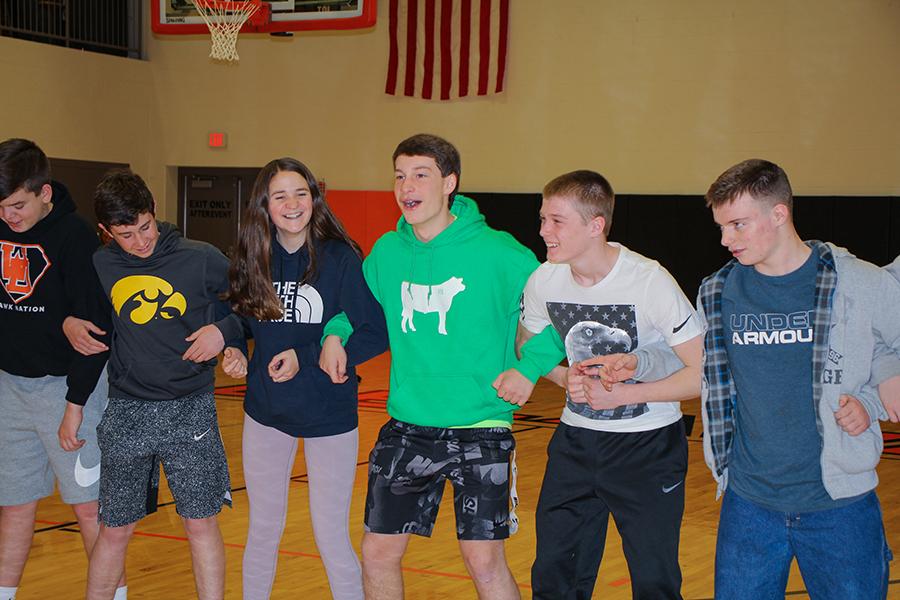 At the freshman retreat, Sam Niles, Nolan Mensen, Ava Neuhaus, Grant Northburg, Logan Peyton and Zachariah O'Rear form a line to participate in the Siamese Feet activity.