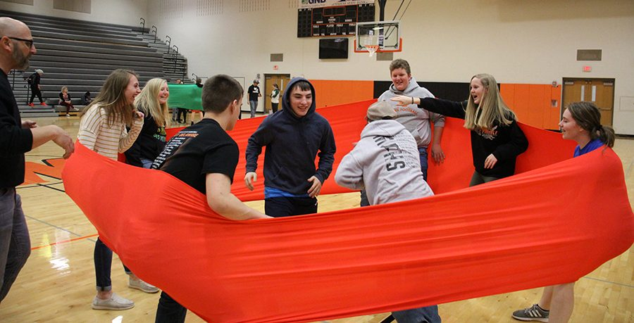 Freshmen Sydney Demmer, Kelly Beckman, Logan Africa, Jacob Fife, Trent Duetmeyer, Connor Andregg, Allie Demmer and Harper Blommers focus on running to the other side of the band while playing Slingshot.