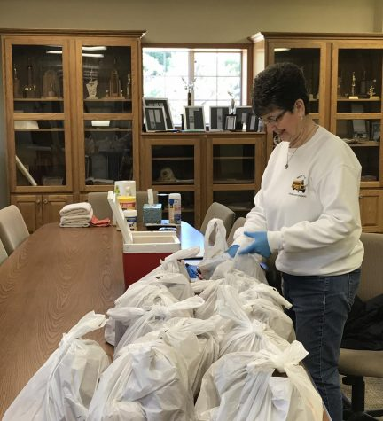 Shirley Mangold packs grab-n-go lunches at the Greeley Fire Station. The last week of April, 530 meals were distributed at this location.