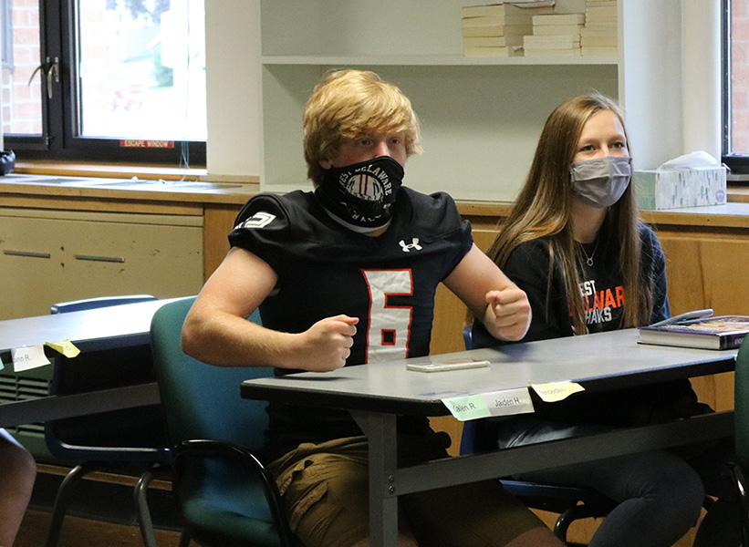 """With excitement and fury, Isaac Fettkether (11) participates in a Homecoming Kahoot led by West Delaware Student Council. Throughout the weeks before Homecoming, West Delaware Student Council prepared socially distanced activities students could participate in. Fettkether said, """"Homecoming week was kind of a let down with all of the changes, and I definitely missed powderpuff the most. The Kahoot and other games were okay, but the reactions of my class made it a whole lot better."""""""
