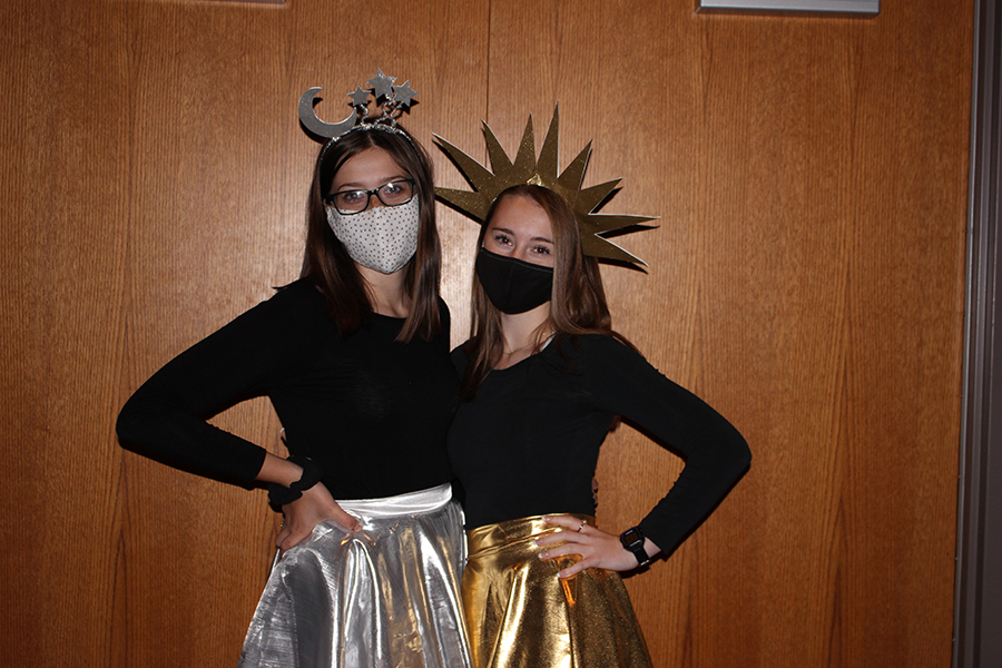 In the excitement of Homecoming Week, seniors Emma Merkes and Katie McGrane dress as the sun and moon for Dynamic Duo Day. The girls created their own costumes and used material they found in second-hand stores and their own homes.