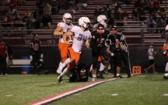 Wyatt Voelker dodges incoming tacklers on Friday night against Clinton to help win the game, 55 to 6.