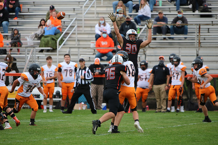 While attempting to block the pass from the Charles City quarterback, Cash Hauser (9) towers over his competition last Friday. The freshman and sophomore Hawks won their Homecoming game with a final score of 35-0.