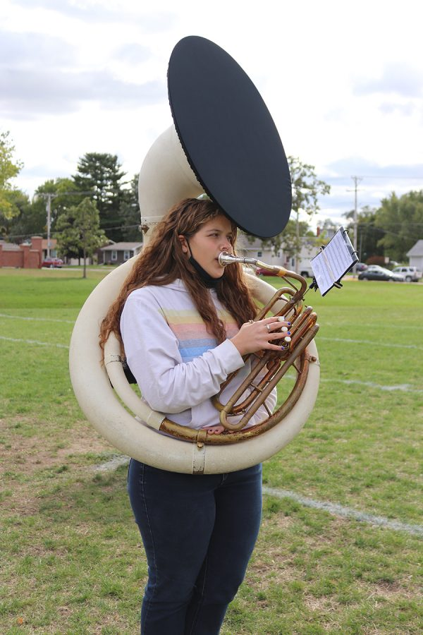 With the new bell cover on her instrument, Samantha Anderson (11) rehearses alongside the rest of the band for an upcoming performance.