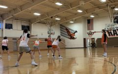 The girls basketball team practices in the Upper Gym.