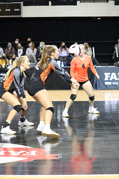 At state finals, Kayla Felton (11) passes the ball to her setter Carlee Smith (11).