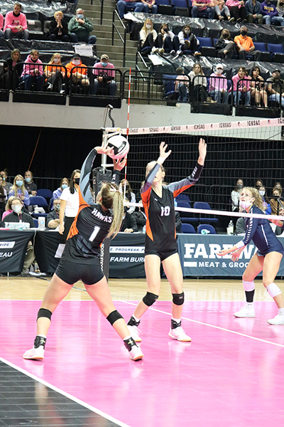 During the championship game, Carlee Smith (11) sets Allie Demmer (10) a quick to gain a point for the Hawks.