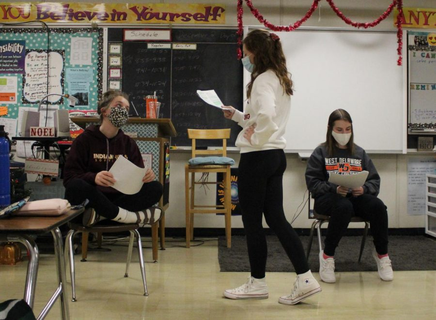 Freshman teammates Audrey Jolley, Elizabeth Sleper and Ava Timmerman read through scripts during practice for their first speech season.