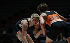 As he lowers his level, Jared Voss (12) hopes to get a take down against Solon opponent. The Hawks beat Solon, 68-7.