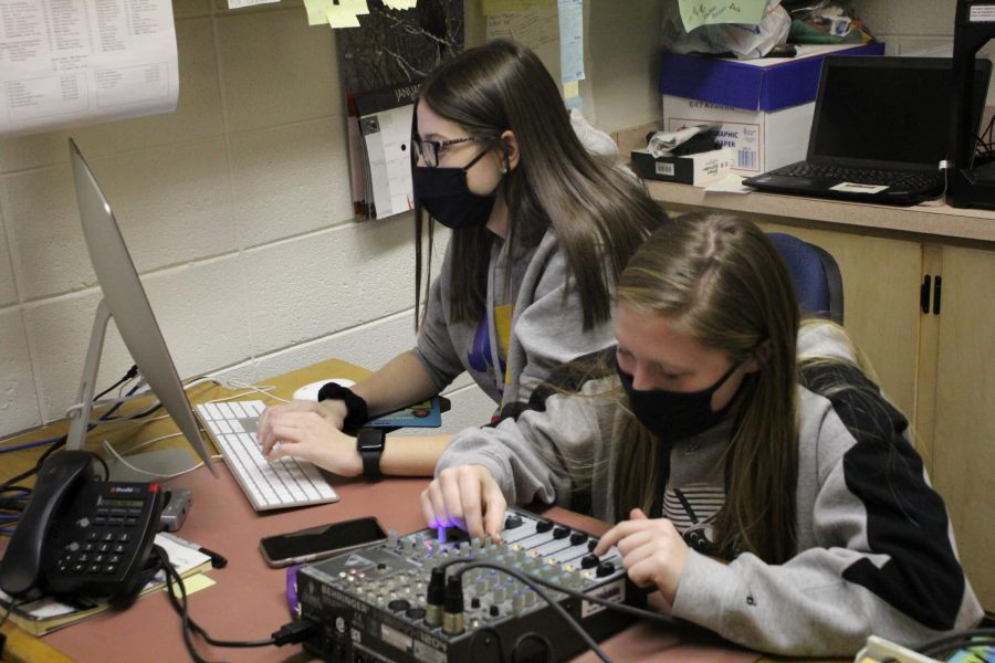 Editing a voice over Emma Merkes (12), and Alissa Holtz (12) work together to finish the recording.