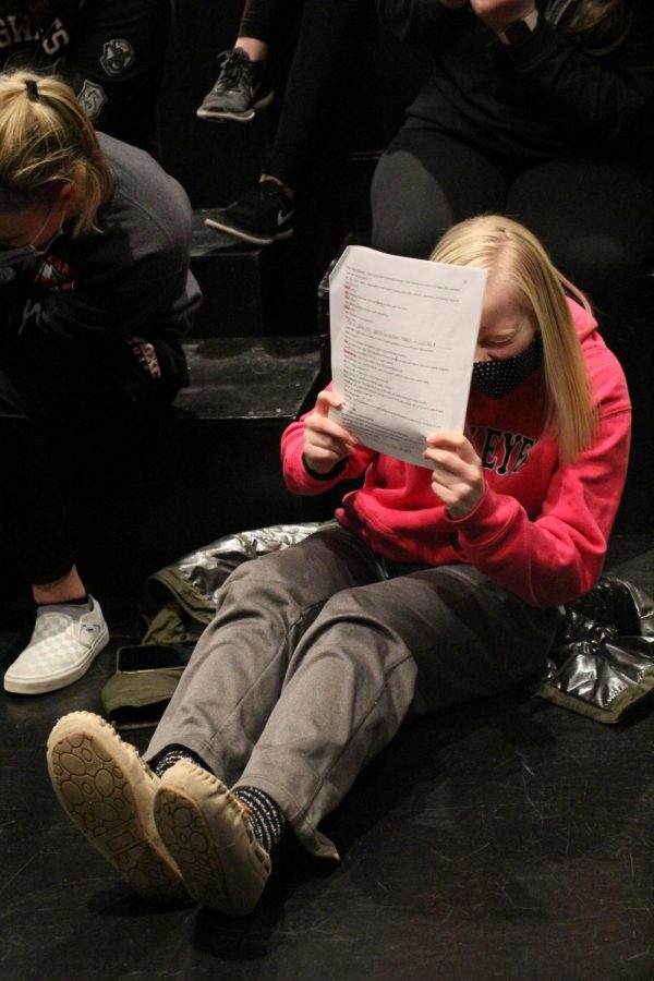 Dodging from snowballs, senior Jadyn Werner acts during Choral reading practice.