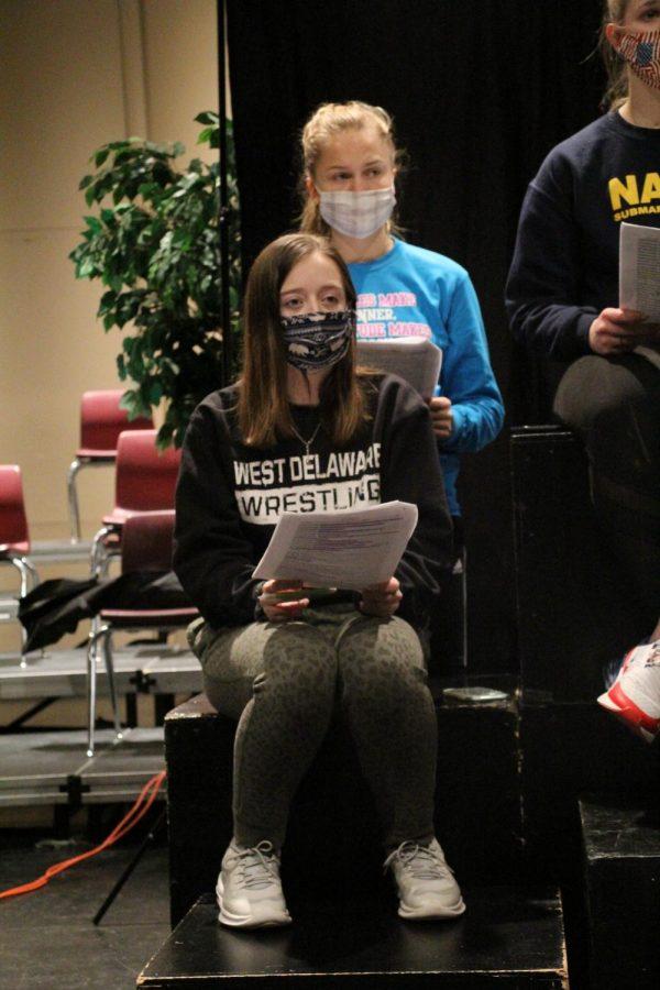 Senior Rebecca Farmer practices her script for Choral Reading.