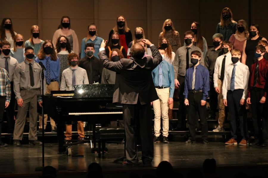 "During ""Song of Triumph,"" director Duane Philgreen conducts concert choir."