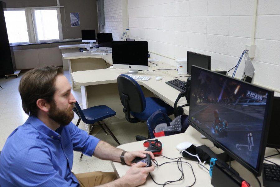 Teacher Christian Carper plays time trials in Mario Kart at a team practice.