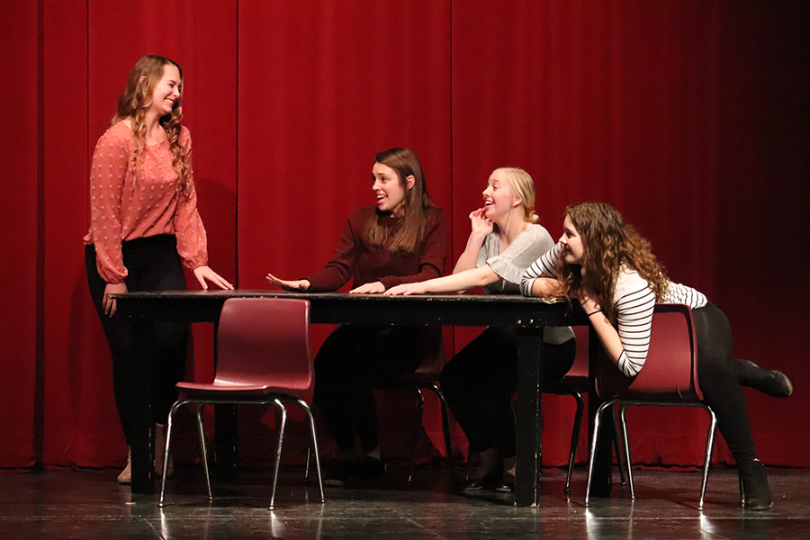 During the ensemble 15 Reasons Not to Be in a Play, Laney Robinson (11), Haley Hamm (11), Jadyn Werner (12) and Samantha Anderson (11) swoon over prince Grant Menard (11).