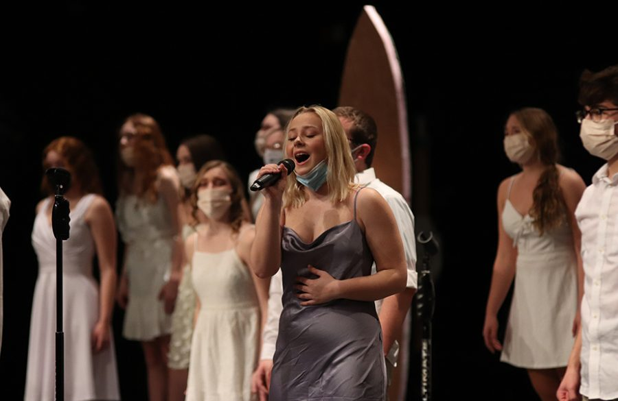 Kaylee Osterhaus (12) belts out her solo in the song