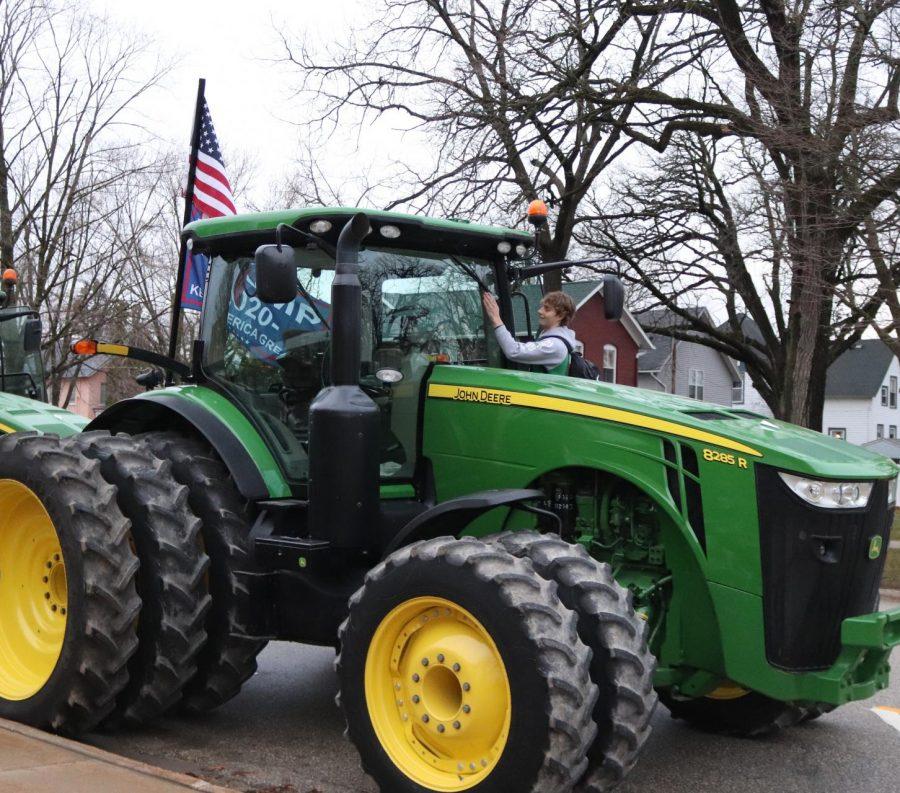 Kaden Ryan (10) exits his John Deere tractor.