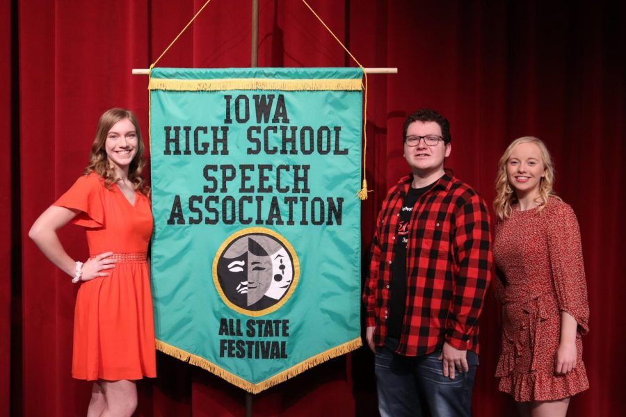 Individual All-State Speech Nominees Addie Reetz, Laiken Blommers and Jadyn Werner pose with the All State Speech banner.