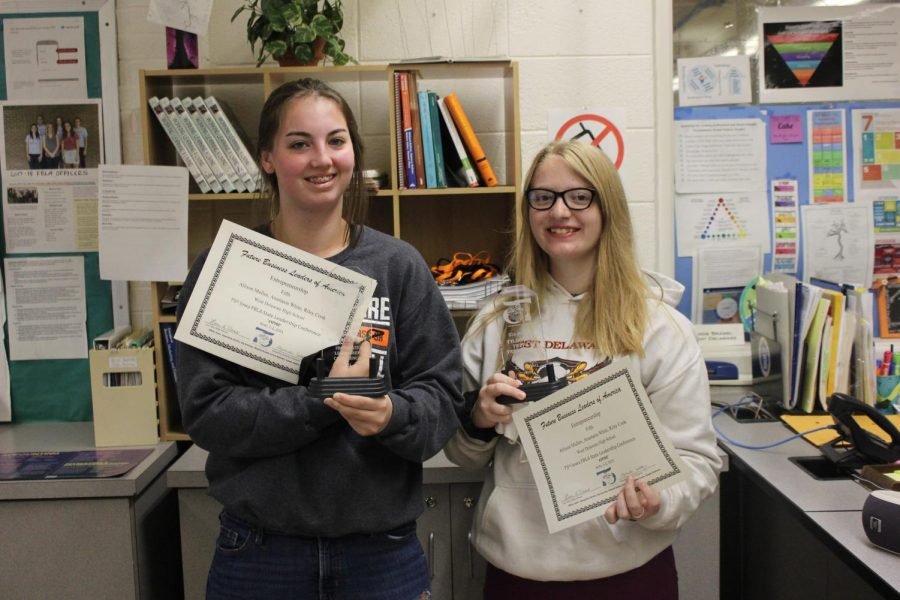 Allison Mullen and Riley Cook hold their trophies and certificates that they won at the Iowa State Leadership Conference.